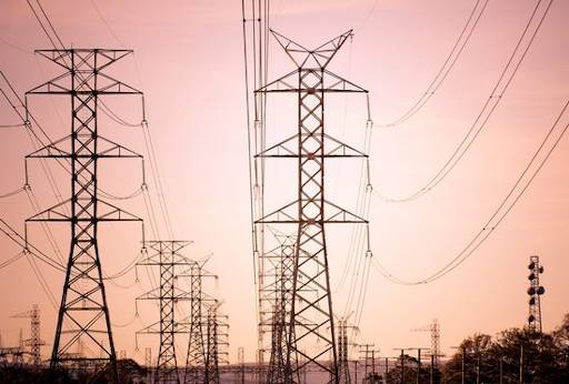 electrical power lines showing sagging due to thermal expansion