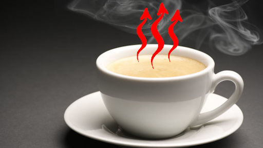 spontaneous process in which hot white cup of coffee is losing heat as an example of second law of thermodynamics